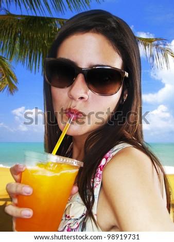 Girl Drinking Frozen Drink - stock photo
