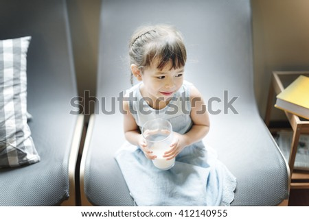 Girl Drinking Milk Hungry Tasty Concept - stock photo