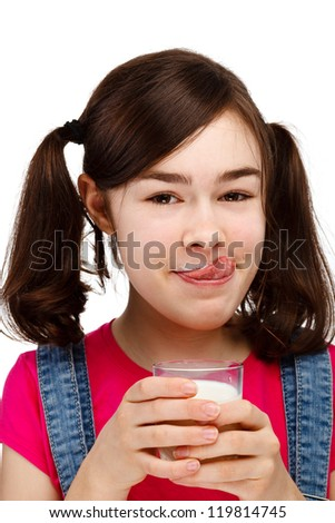 Girl drinking milk isolated on white background