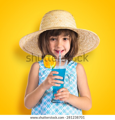 Girl drinking soda over colorful background - stock photo