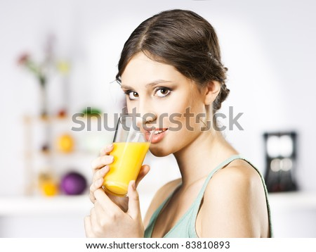 girl drinks juice in kitchen - stock photo