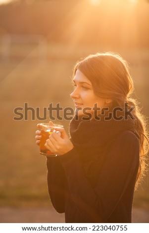 girl drinks tea in autumn - stock photo