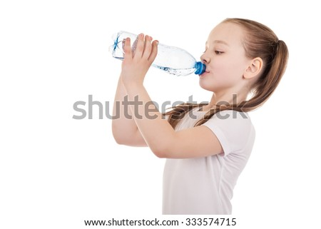 Girl drinks water from a bottle - stock photo