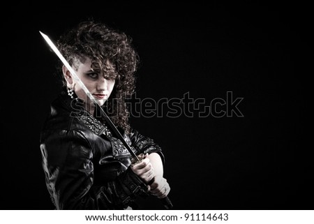 Girl - Ear super piercing woman dark hair natural brown-haired holding hands katana sword