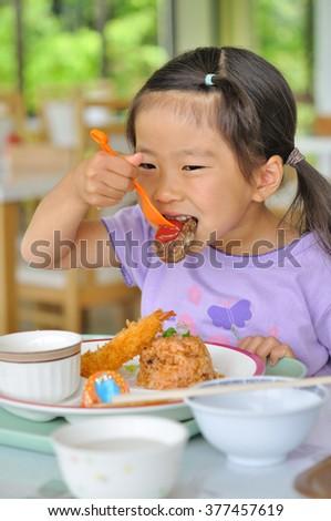Girl eat dinner menu for children - stock photo