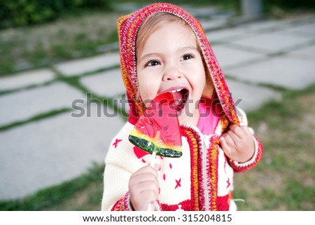 Girl eating a candy - stock photo