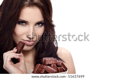 Girl eating a chocolate candy - stock photo