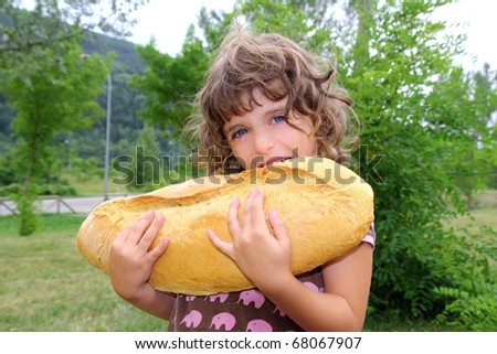 girl eating big bread humor size hungry child funny gesture