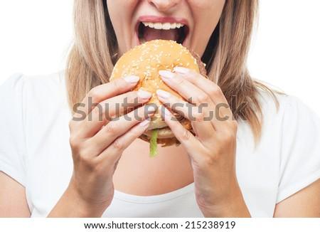 girl eating burger on white background - stock photo