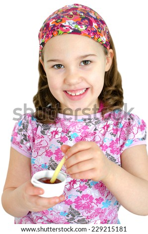 Girl eating chips with dip - stock photo
