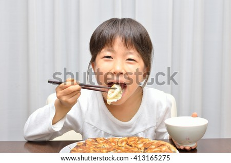 Girl eating delicious chinese dumplings