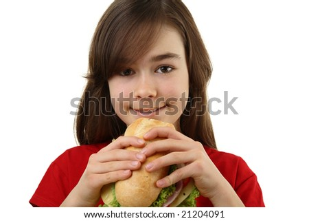 Girl eating healthy sandwich isolated on white