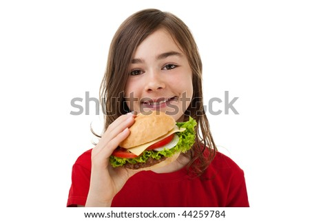 Girl eating healthy sandwich isolated on white background - stock photo