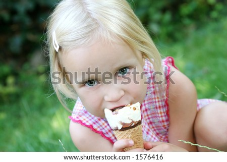 Girl eating ice cream - stock photo