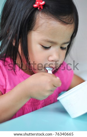 Girl eating ice cream - stock photo