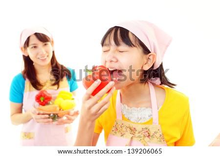 Girl eating Vegetable - stock photo