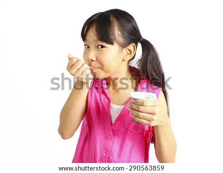 Girl eating yogurt isolated on white - stock photo