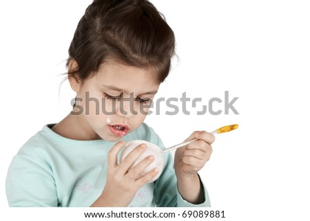 girl eating yogurt isolated  on white background - stock photo