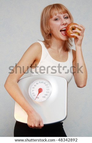 Girl eats a red apple. - stock photo