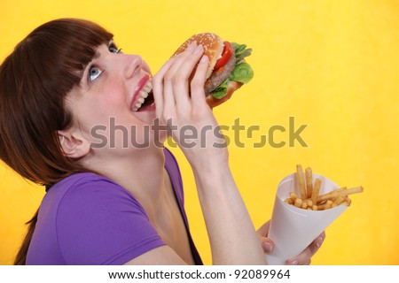 girl ecstatic over hamburger meal with fries