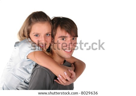 girl embraces boy from back on white - stock photo