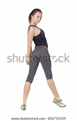 Girl engaged in fitness. Isolated on white.