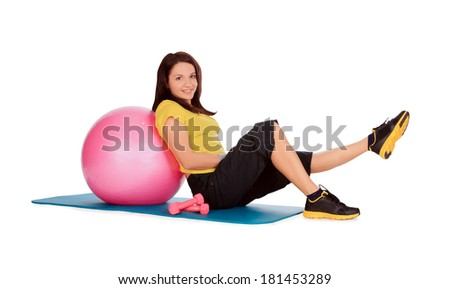 girl engaged on the ball in the gym - stock photo