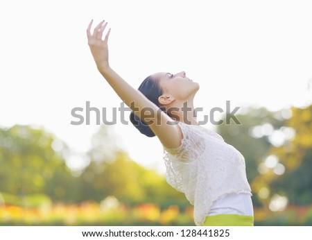 Girl enjoying spring outdoors - stock photo