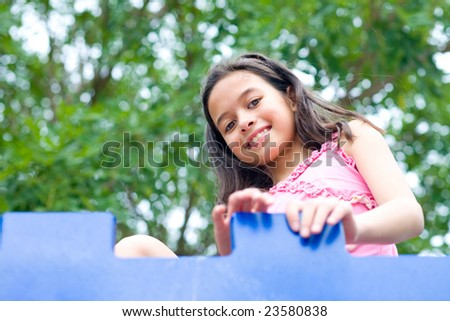 Girl enjoying the outdoor playground - stock photo