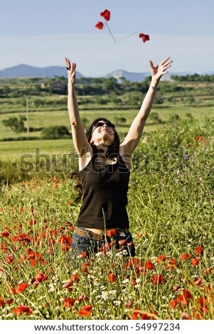 Girl enjoying the spring in the field - stock photo