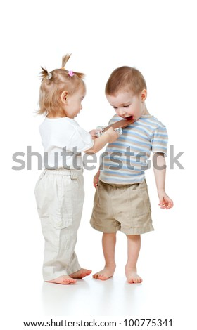 girl entertaining boy by chocolate isolated on white