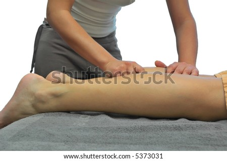 Girl executing leg massage in sap center. - stock photo