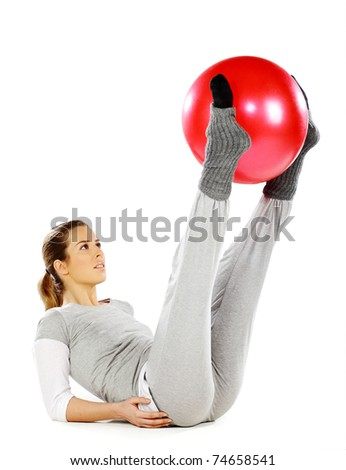 Girl exercising with a red ball, on a white background - stock photo