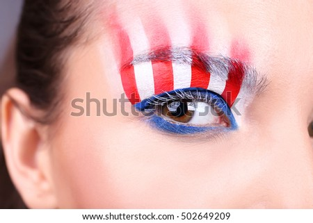 Girl eye with USA makeup, closeup