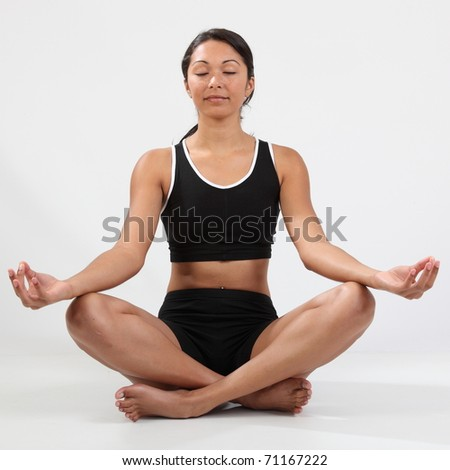 Girl eyes closed relaxing in meditation pose - stock photo