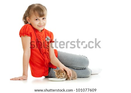 Girl feeding homeless alley cat - stock photo