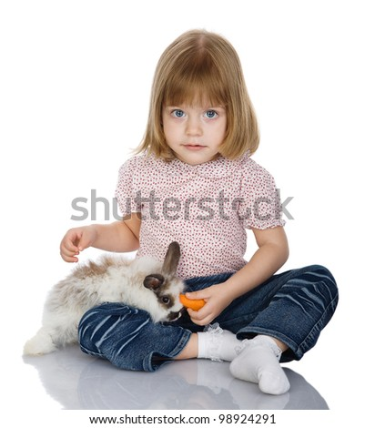 girl feeds a rabbit. isolated on white background