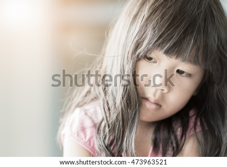 girl feeling alone sad or lonely on vintage tone, with soft focus