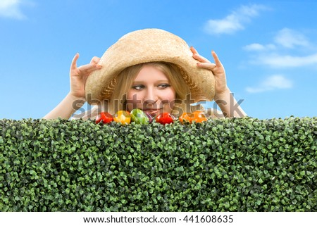 Girl finds a easter egg in the green grass. - stock photo