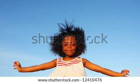 Girl flapping her arms like a bird - stock photo