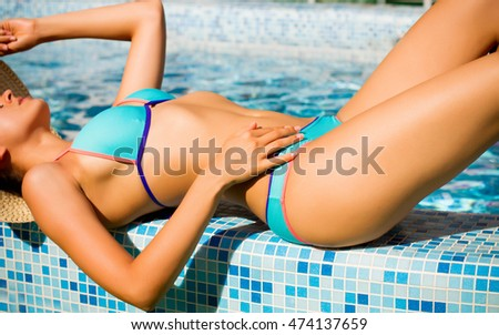 Girl floating  in the blue pool
