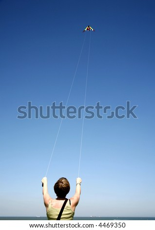 Girl flying a kite. - stock photo