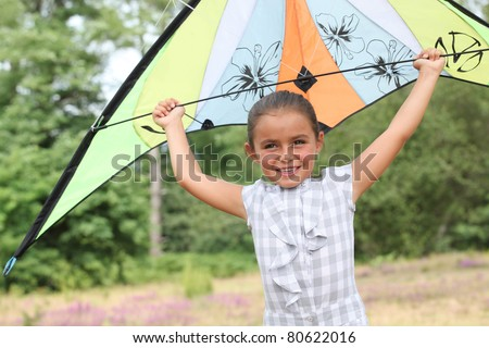 Girl flying her kite