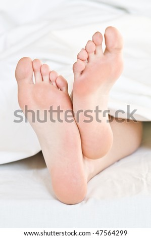 girl foots in bed closeup