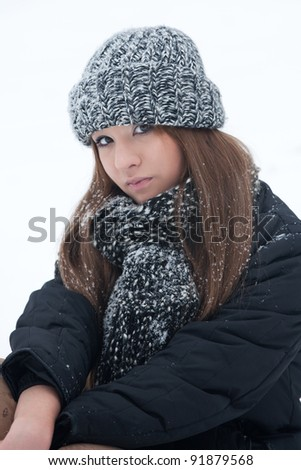 Girl for a walk in the park in the winter