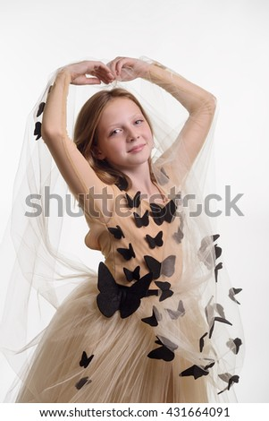 Girl forms heart with her rised hands with beige veil in fingers. Sincere smile and big blue eyes. Warm emotions after buying of the dress. - stock photo