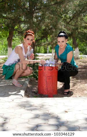 Girl found money in a garbage can - stock photo