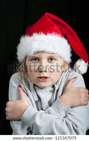 Girl freezing cold at christmas time - stock photo