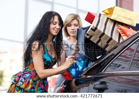 Girl-friends after shopping - stock photo