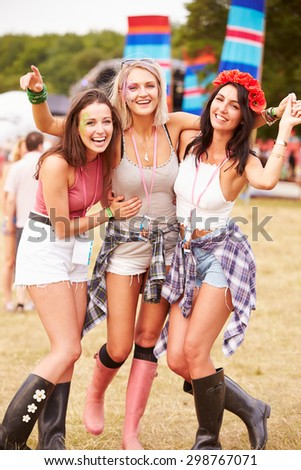 Girl friends hanging out together at a music festival - stock photo